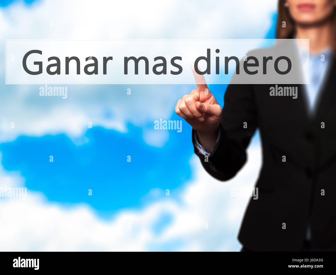 Ganar Mas Dinero (Make More Money in Spanish)  - Businesswoman hand pressing button on touch screen interface. Business, - Stock Image