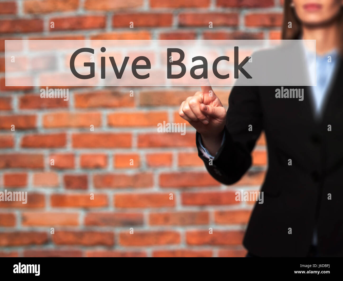 Give Back - Businesswoman hand pressing button on touch screen interface. Business, technology, internet concept. - Stock Image