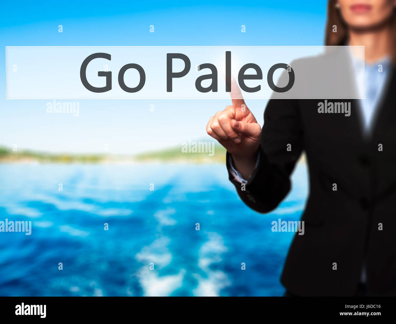 Go Paleo - Businesswoman hand pressing button on touch screen interface. Business, technology, internet concept. - Stock Image
