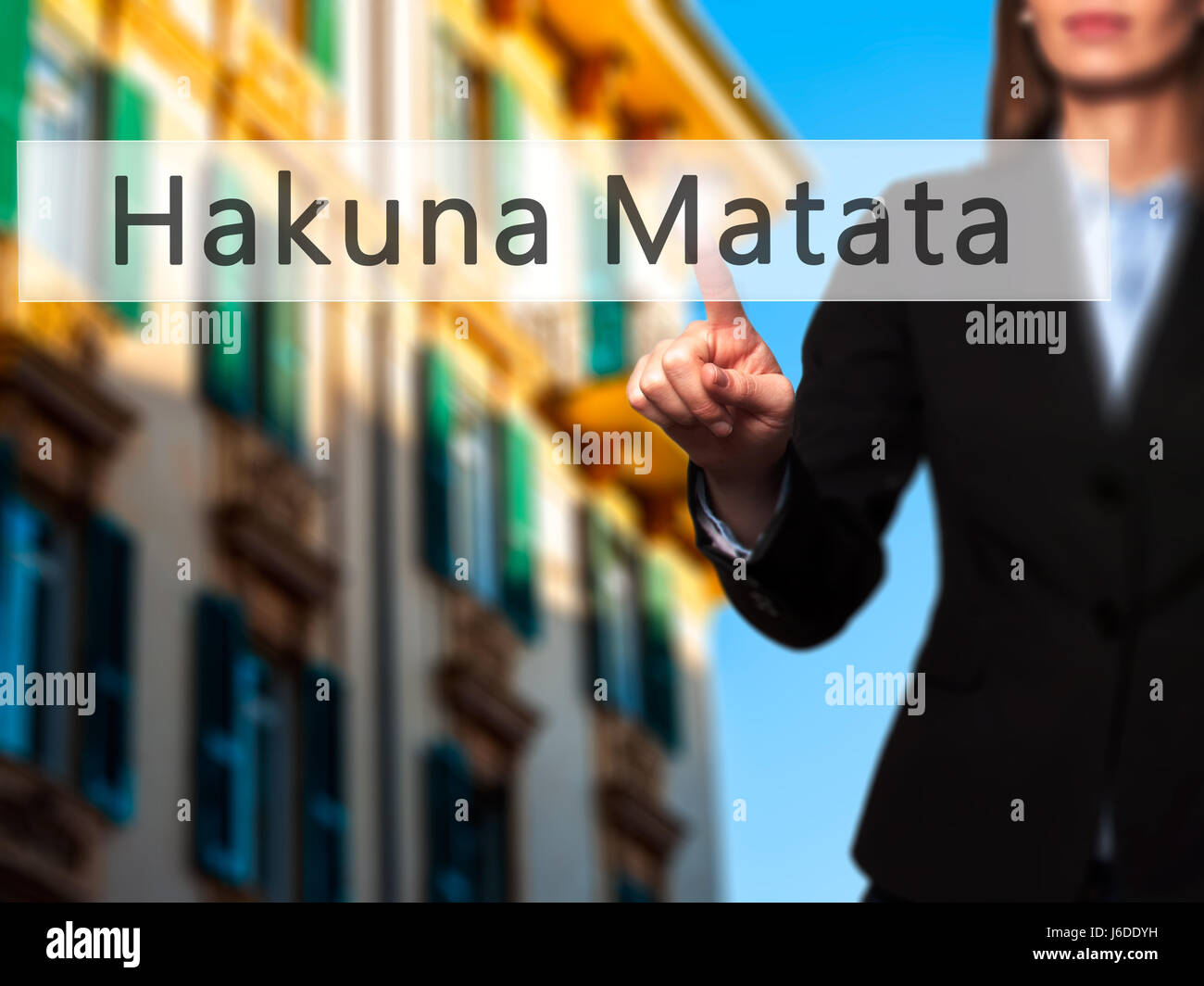 Hakuna Matata (Swahili phrase it means no worries) - Businesswoman hand pressing button on touch screen interface. - Stock Image