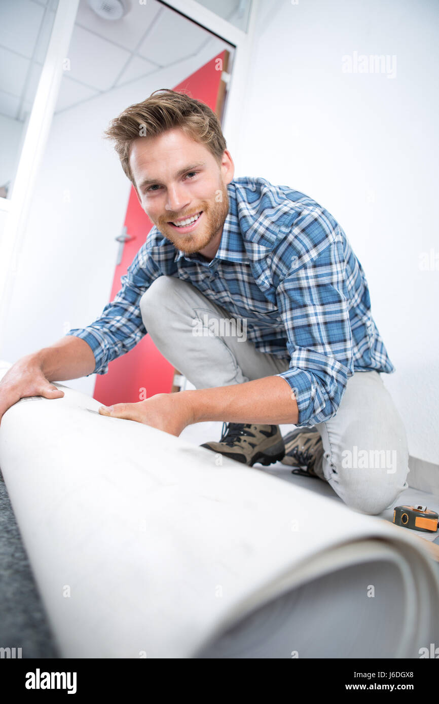 Portrait of carpet fitter - Stock Image