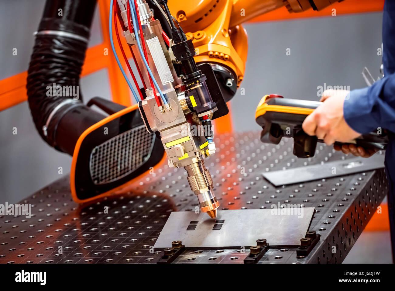 Fibre laser robotic remote cutting system. CNC Laser plasma cutting of metal, modern industrial technology. - Stock Image