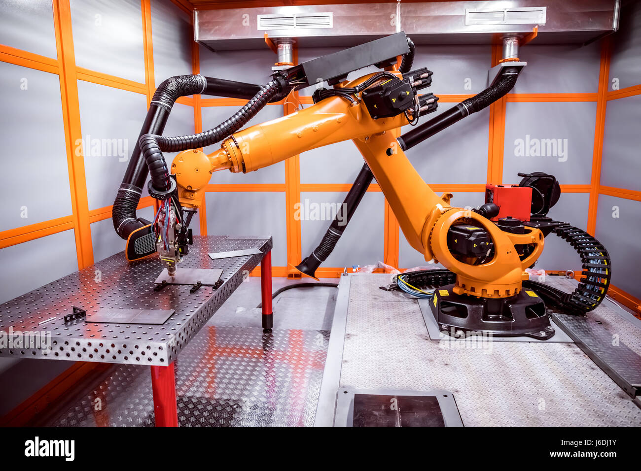 Fibre laser robotic remote cutting system. CNC Laser plasma cutting of metal, modern industrial technology. - Stock Image