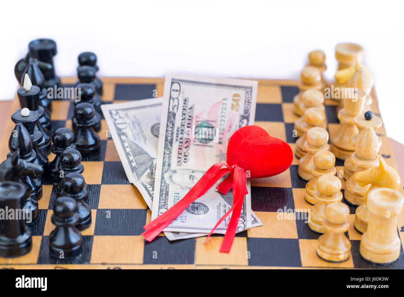 Love, money, power triangle with chess opponents - Stock Image