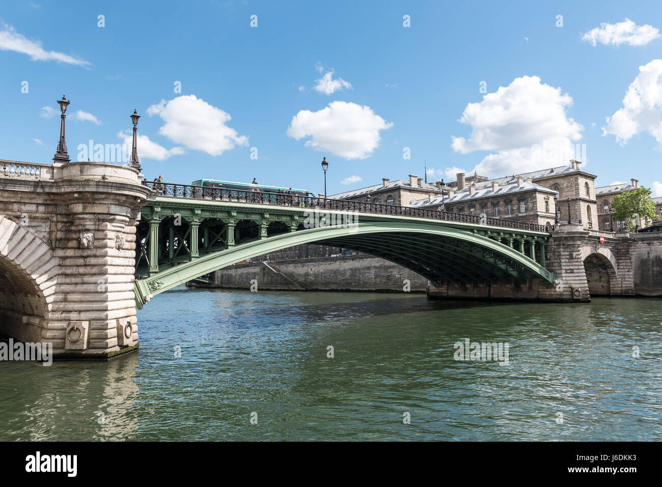 Notre-Dame Bridge in Paris France on a sunny day with blue cloudy sky - Stock Image