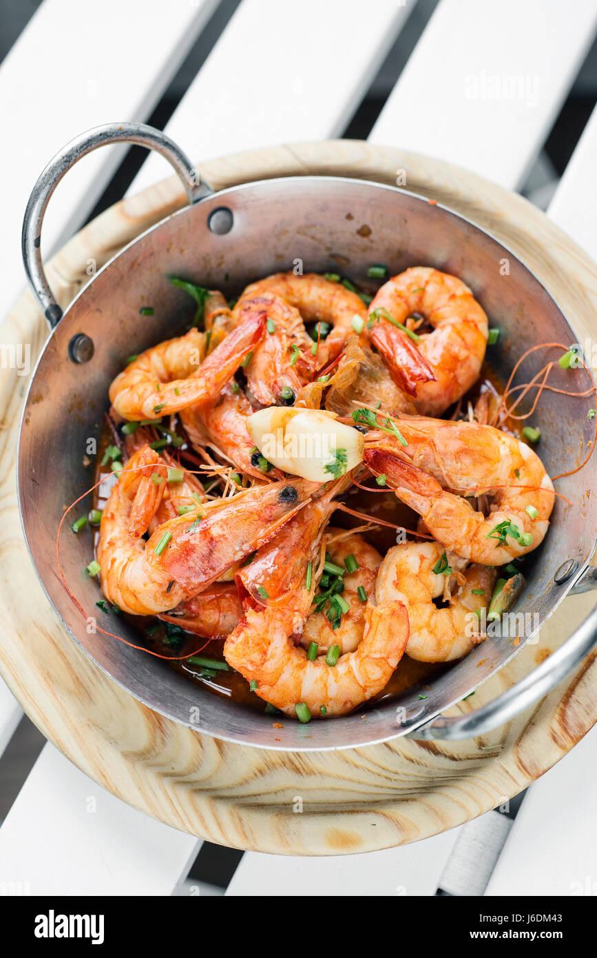 portuguese garlic and herb boiled fresh prawns tapas snack set - Stock Image