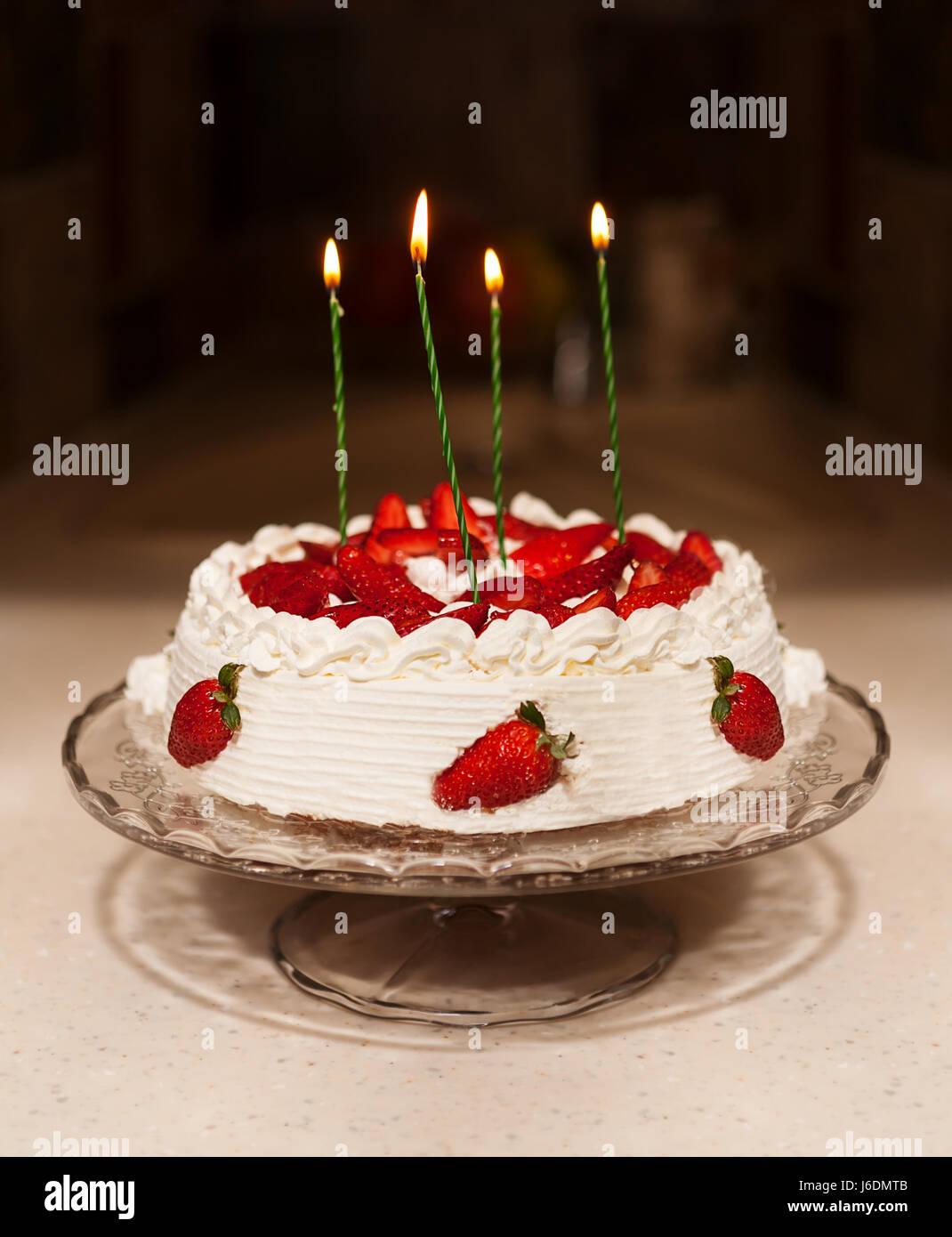 Birthday Cake With Candles Bright Lights Bokeh On Table