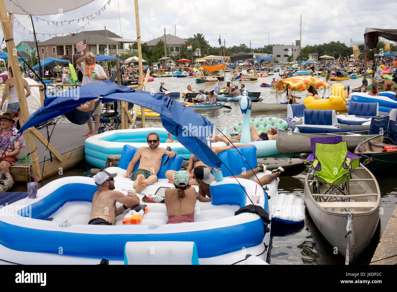 Crowds of boaters enjoying the water on Bayou St John.  Bayou Boogaloo Festival, New Orleans. - Stock Image