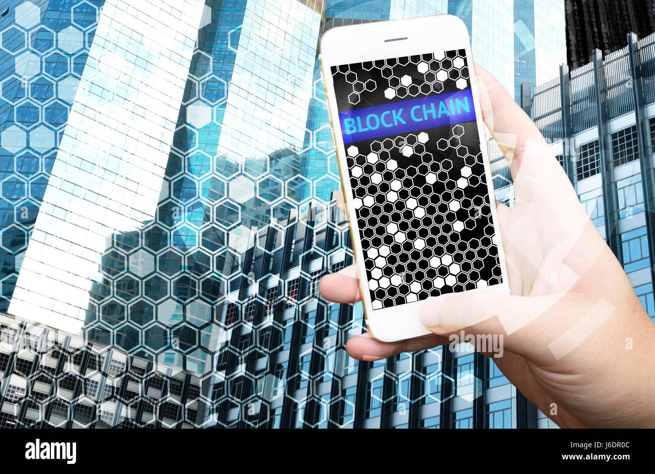 Distributed ledger technology , Man holding mobile phone, block chain text and blockchain icons with smart building - Stock Image
