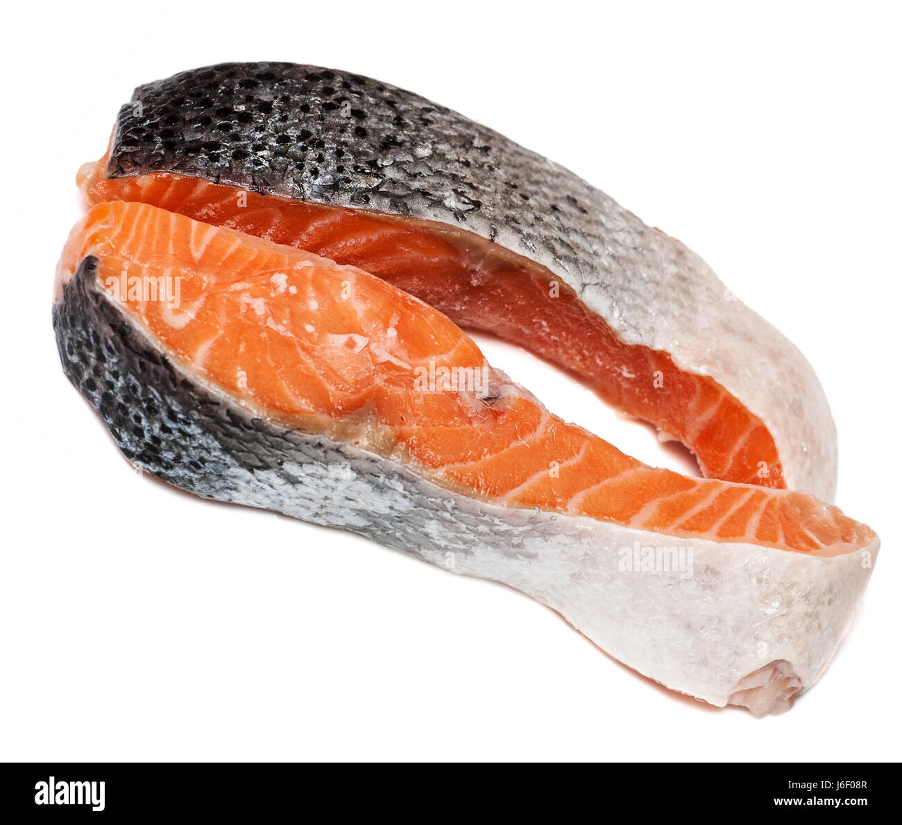 Two stakes from raw salmon fish isolated on white background - Stock Image