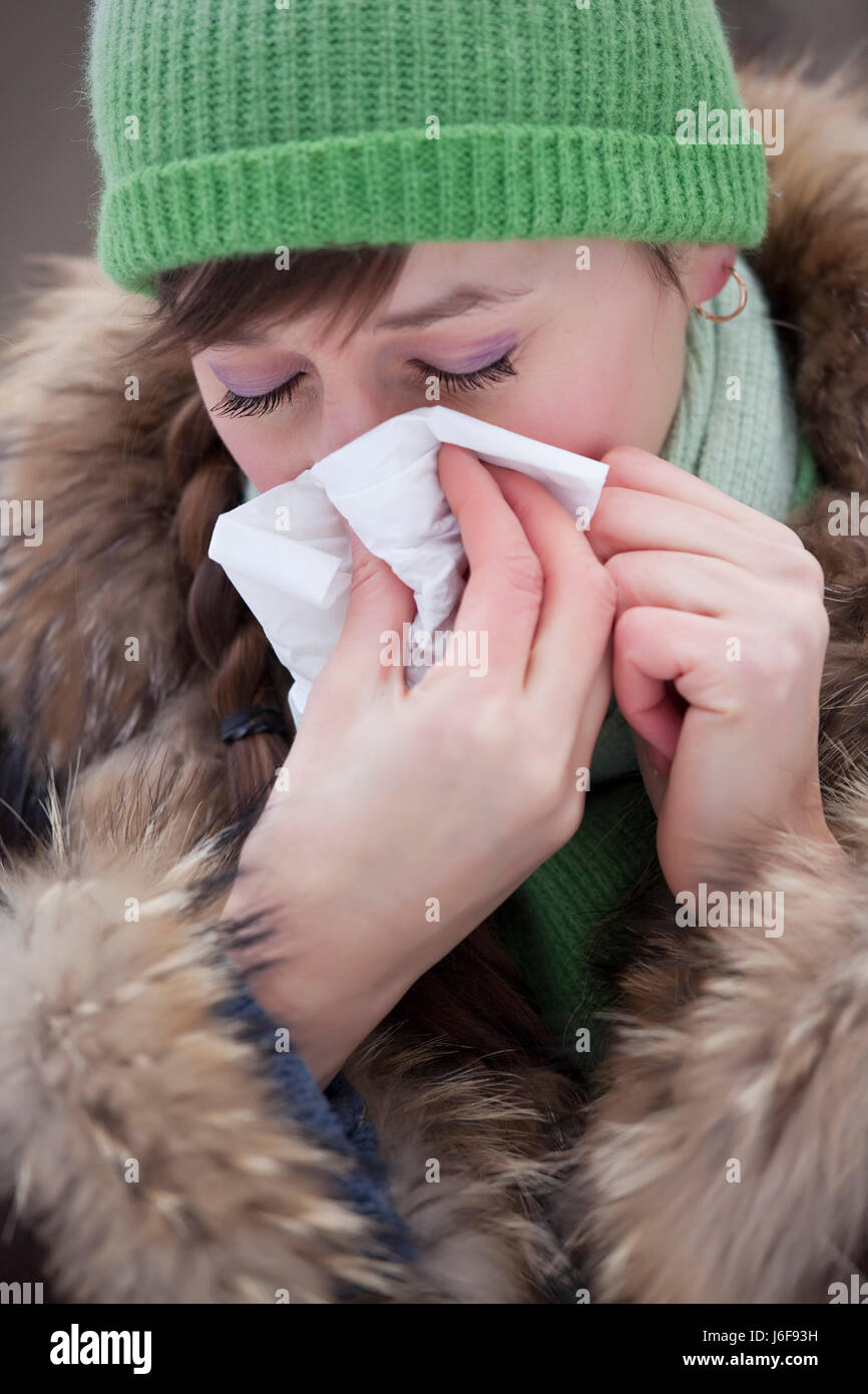 woman walk go going walking winter snow coke cocaine material drug anaesthetic - Stock Image