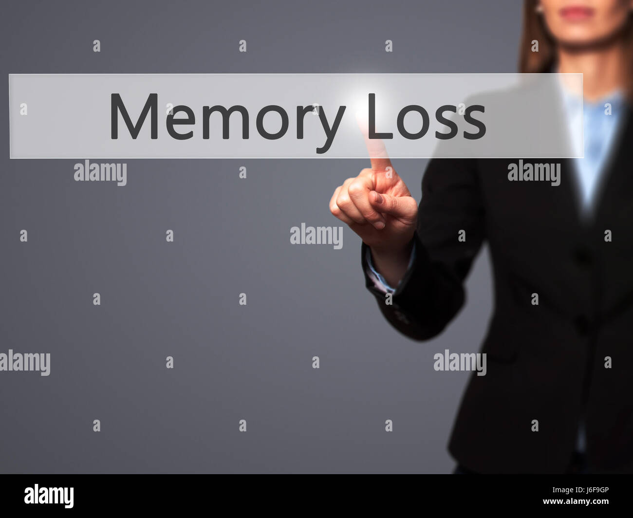 Memory Loss - Businesswoman pressing high tech  modern button on a virtual background. Business, technology, internet - Stock Image