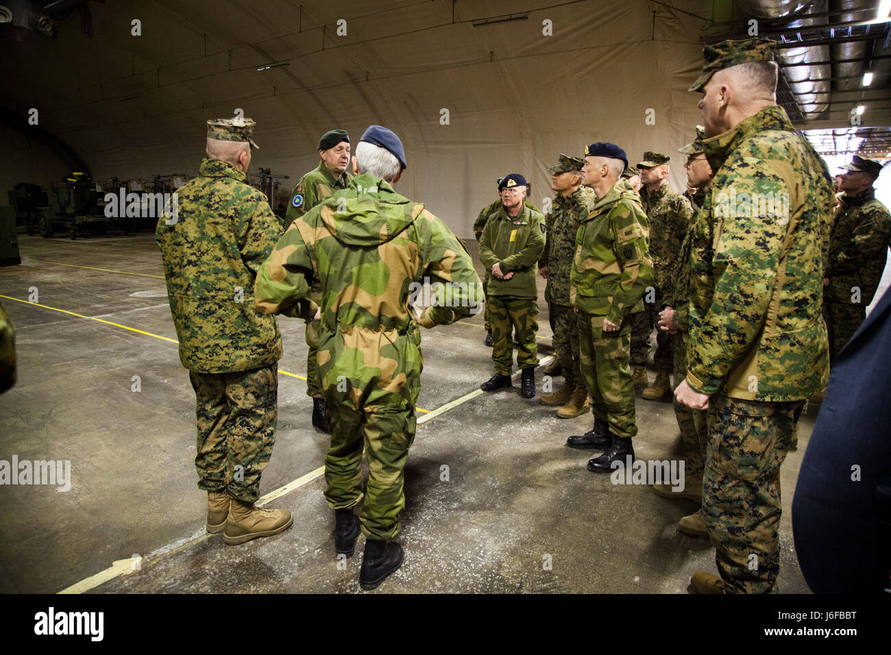Capt. Ola Gilberg, Frigaard Cave Manager, gives U.S. Marines and Norwegians a tour of a cave site in Norway, May Stock Photo