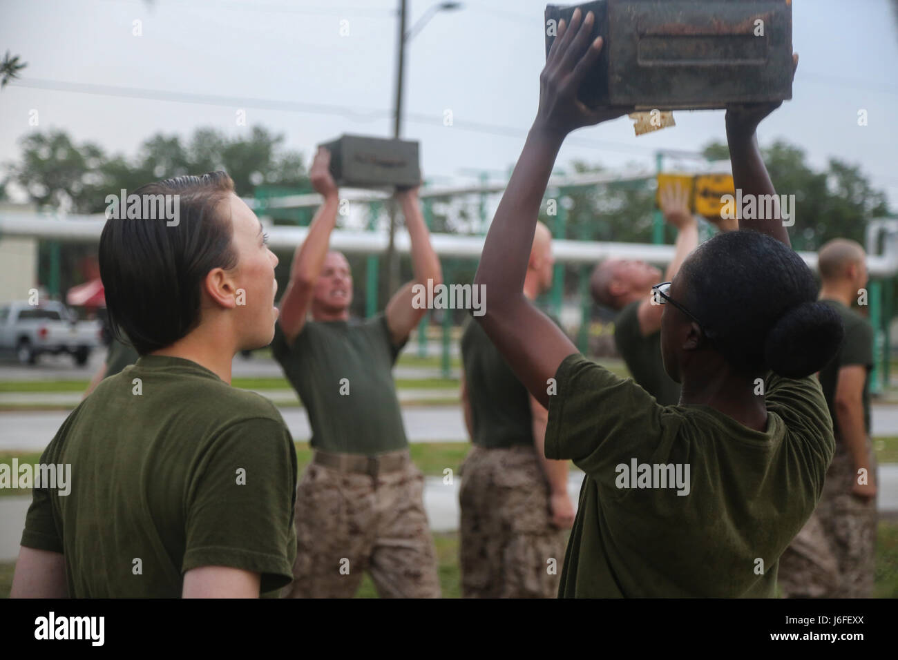 U.S. Marine Corps Recruits with Company O, 4th Battalion and Company G, 2nd Battalion execute ammunition can lifts - Stock Image