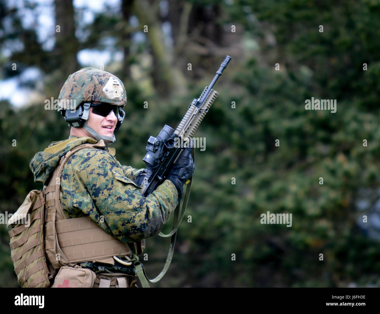 U.S. Marine Corps Sgt. Joshua Godfrey, foreign weapons instructor, Combat  Marksmanship Company, Weapons Training Battalion, awaits further  instruction for a ...
