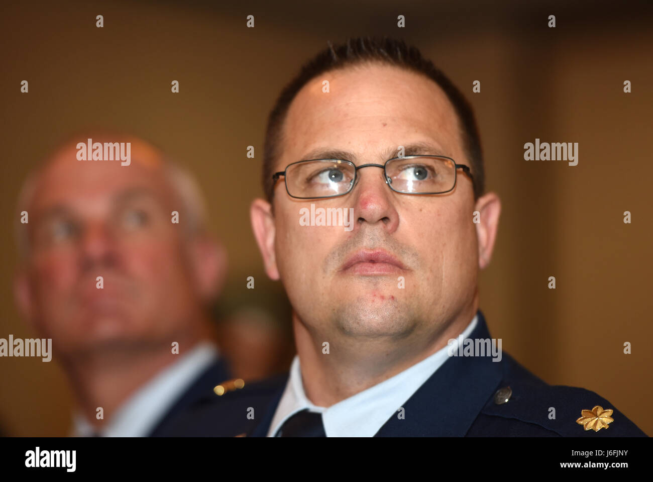 Air Force Maj. John Brownell, with the Nevada Air National Guard, listens to a keynote speaker at the 2017 Federal Stock Photo