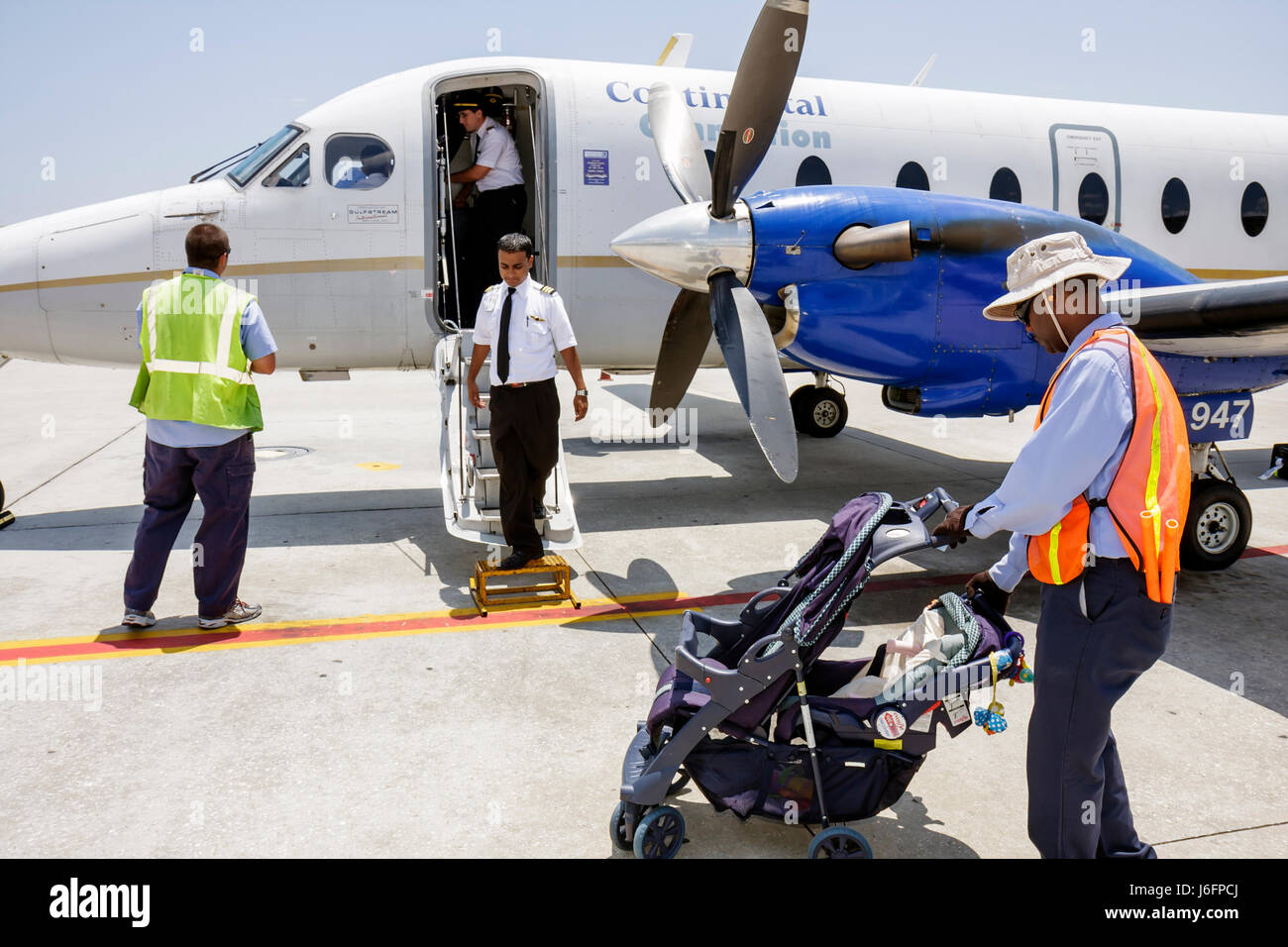 Tampa Florida Tampa Airport Continental Airlines Connection commuter flight aircraft tarmac man men co-pilot ground - Stock Image