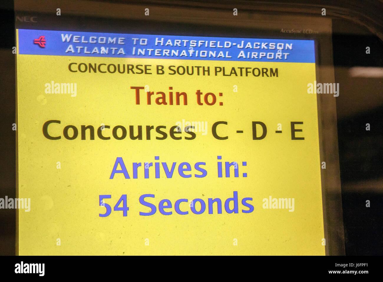 Atlanta Georgia Hartsfield-Jackson Atlanta International Airport information screen concourse train arrival schedule - Stock Image
