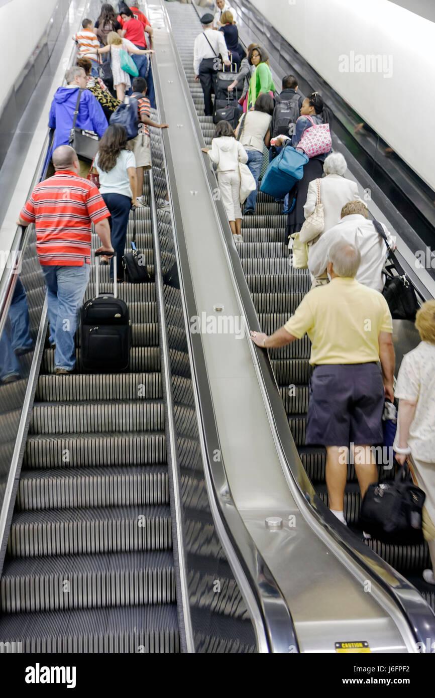 Atlanta Georgia Hartsfield-Jackson Atlanta International Airport escalator up ascend men women luggage side by side - Stock Image
