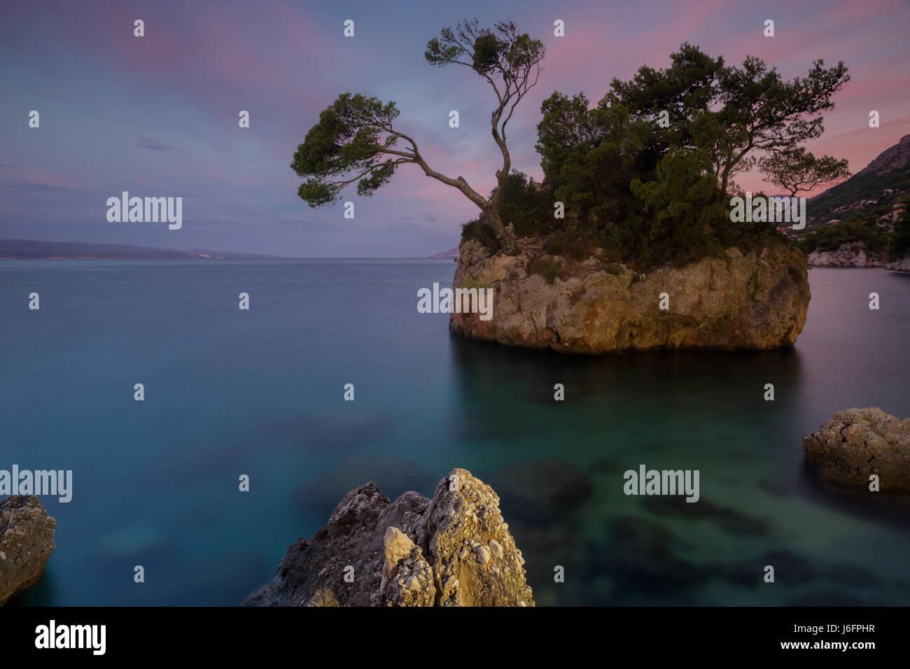Rock on famous beach in place Brela, Dalmatia, Croatia - Stock Image