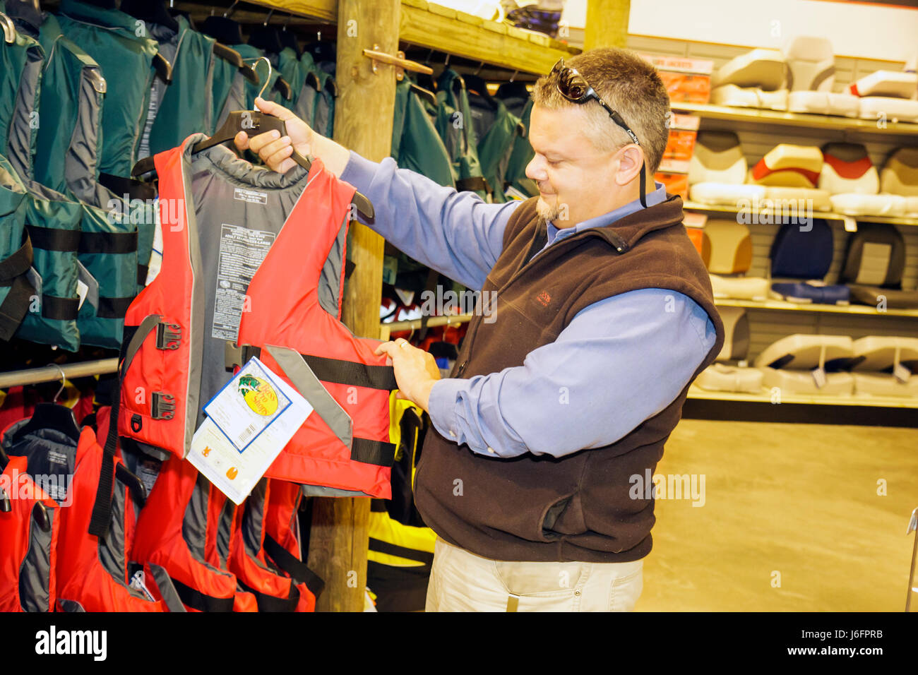 4a1dc02973 Tennessee Sevierville Kodak Bass Pro Shops man shopping sporting goods  outdoor recreation boating gear fishing retail store life