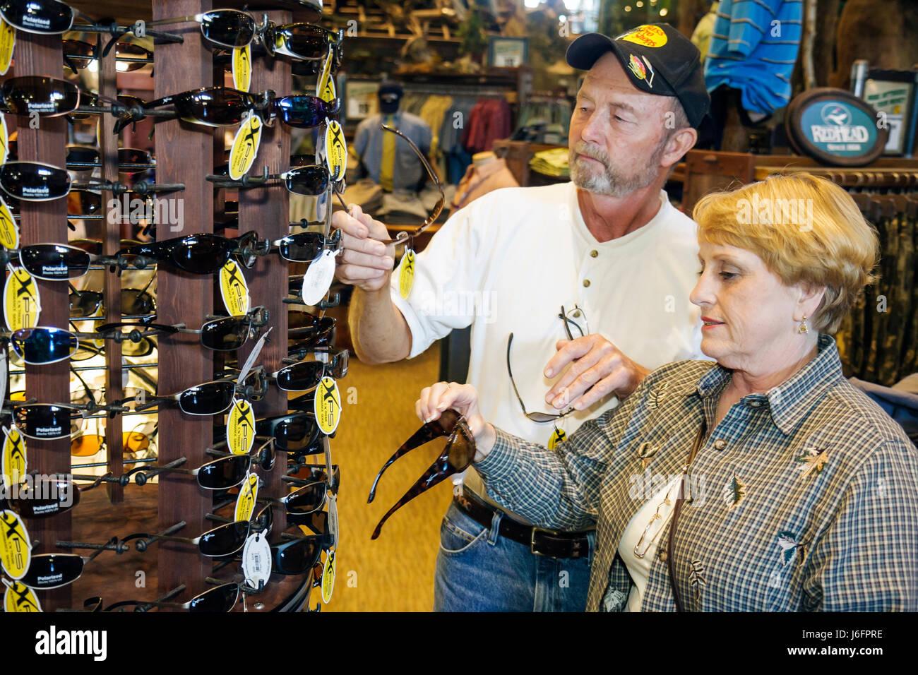 d2f0888c3c Tennessee Sevierville Kodak Bass Pro Shops man woman couple shopping  sunglasses merchandise sporting goods outdoor recreation su