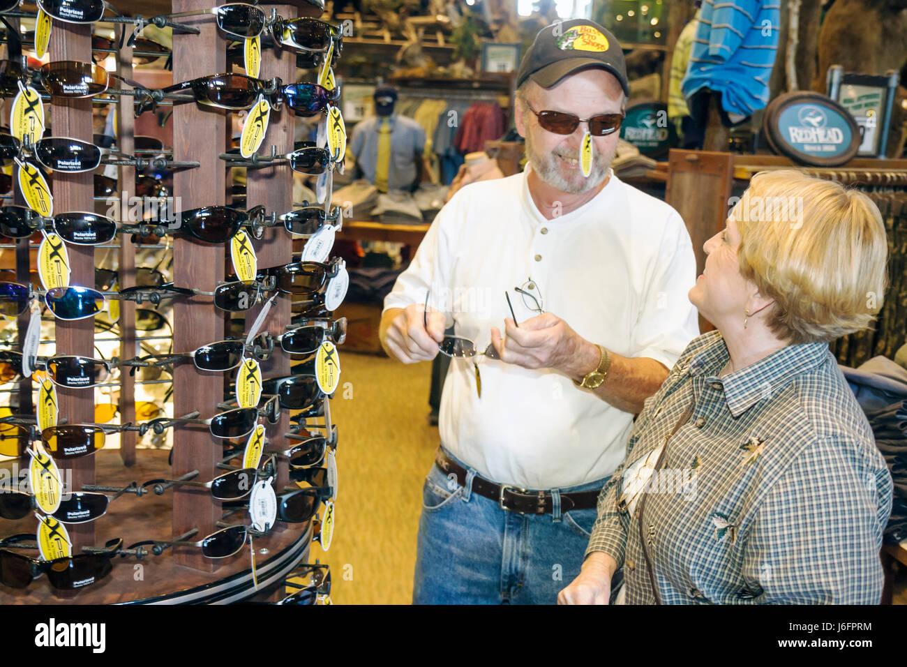 a3c606a550 Tennessee Sevierville Kodak Bass Pro Shops man woman couple shopping  sunglasses merchandise sporting goods outdoor -