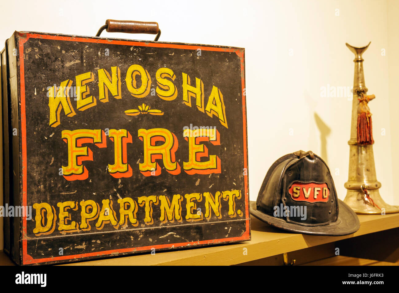 Wisconsin Kenosha Simmons Island Southport Kenosha History Center Yesteryear Gallery fire department helmet horn - Stock Image