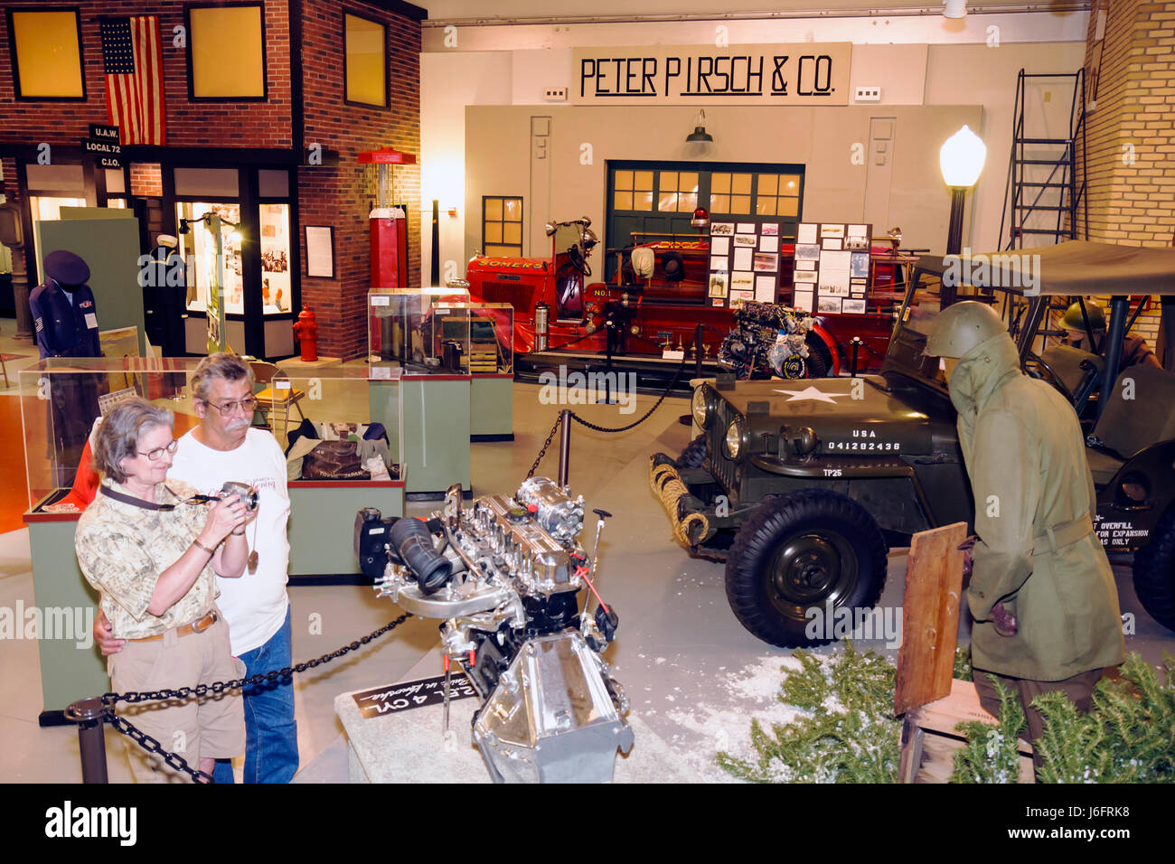 Wisconsin Kenosha Simmons Island Kenosha History Center Yesteryear Gallery man woman couple WWII jeep engine soldier - Stock Image