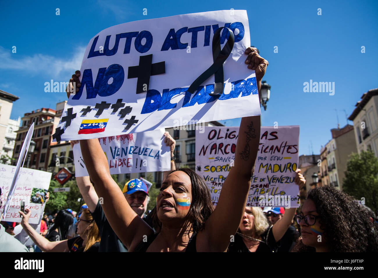 Madrid, Spain. 20th May, 2017. Venezuelan woman protesting with placard against Nicolas Maduro. Credit: Marcos del Stock Photo
