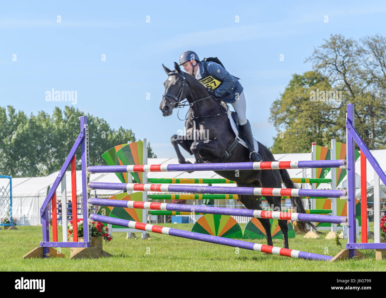 Rockingham Castle, Corby, UK. 21st May, 2017. Rider Paul Graham and his horse Weston One Vision leap over the top Stock Photo