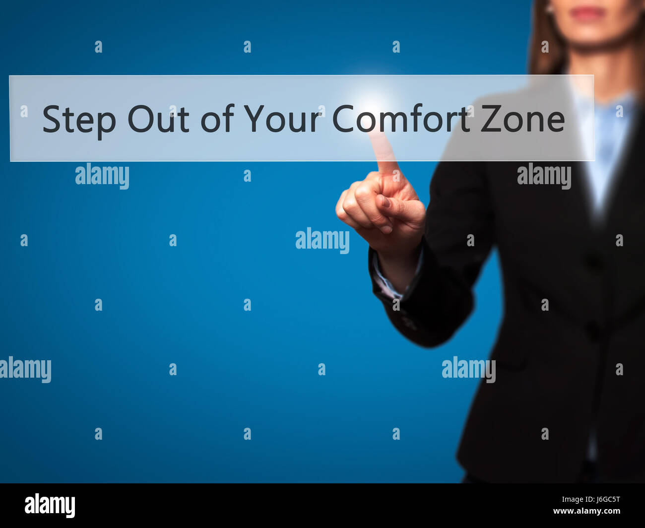 Step Out of Your Comfort Zone - Businesswoman hand pressing button on touch screen interface. Business, technology, internet concept. Stock Photo Stock Photo