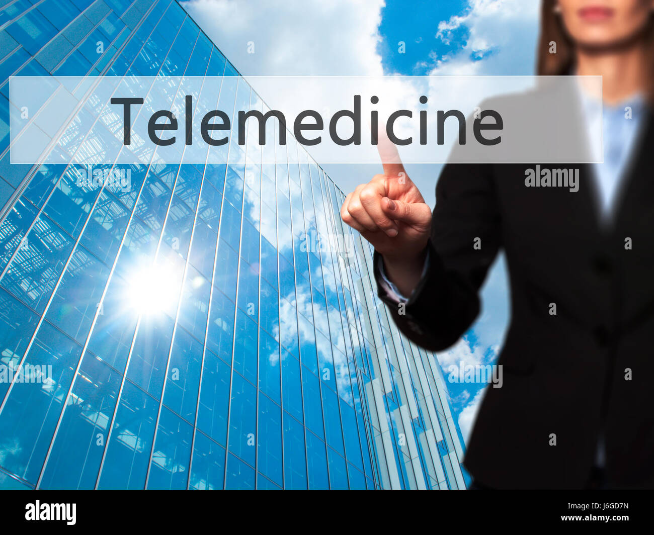 Telemedicine - Businesswoman hand pressing button on touch screen interface. Business, technology, internet concept. - Stock Image