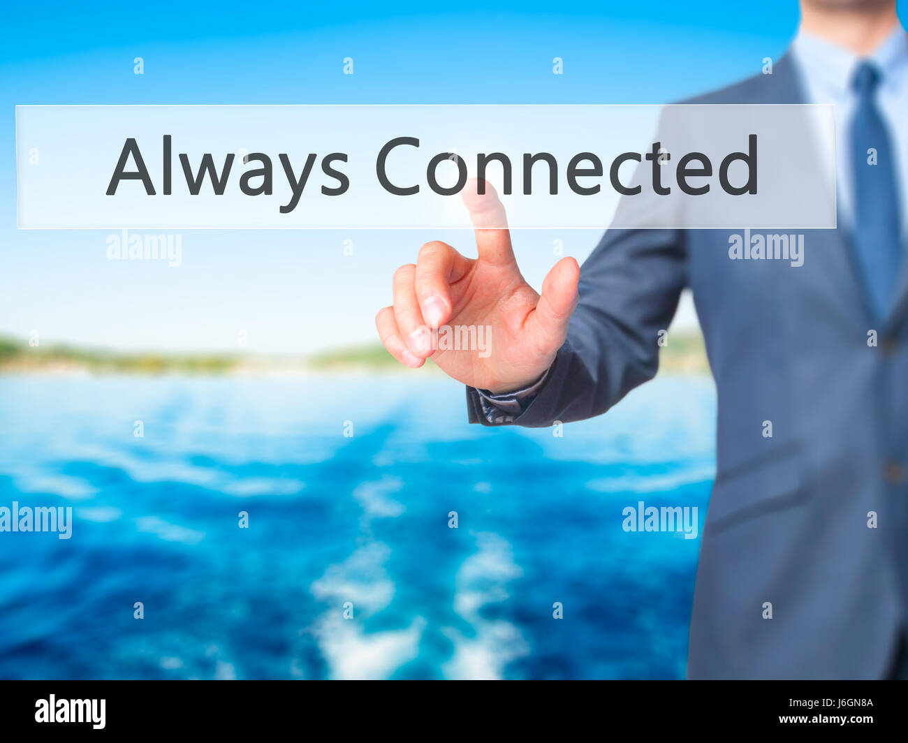 Always Connected - Businessman hand pressing button on touch screen interface. Business, technology, internet concept. - Stock Image