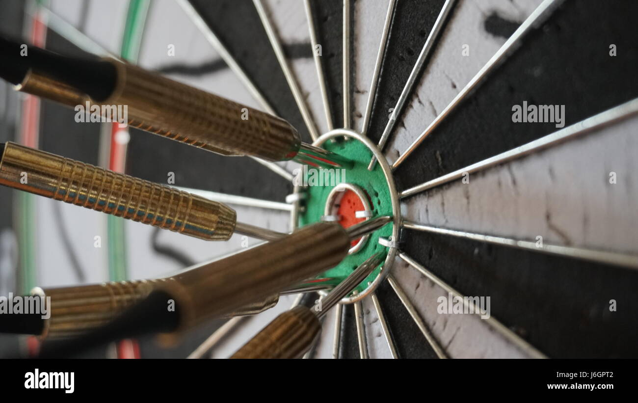 Business concept of darts. The target hanged on the wall - Stock Image