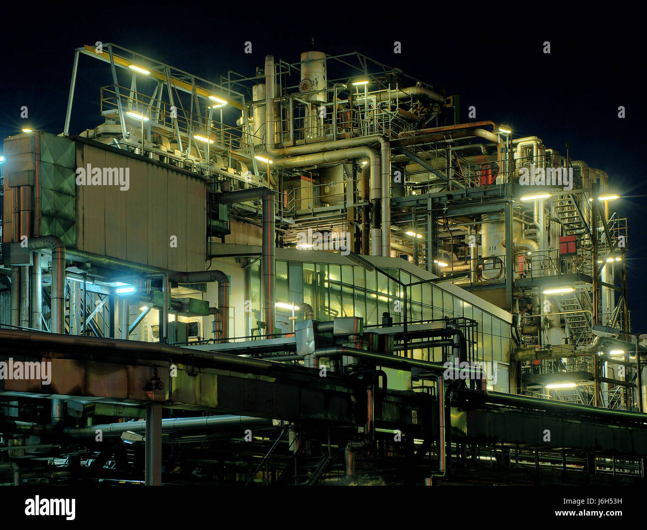 industry at night tube wax chemistry distillation paraffin industry at night - Stock Image