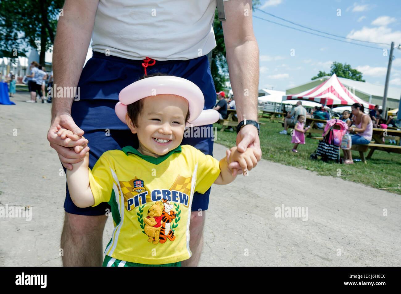 Wisconsin Kenosha Kenosha County Fairgrounds The Ultimate Kid Fest family event Asian boy parent childhood fun - Stock Image