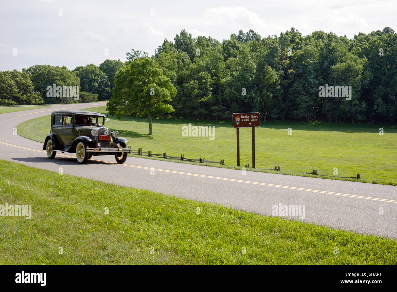 Blue Ridge Parkway Virginia,Appalachian Mountains,Rocky Knob,antique car,Model A Ford,sign,road,grassy field,VA090621068 Stock Photo