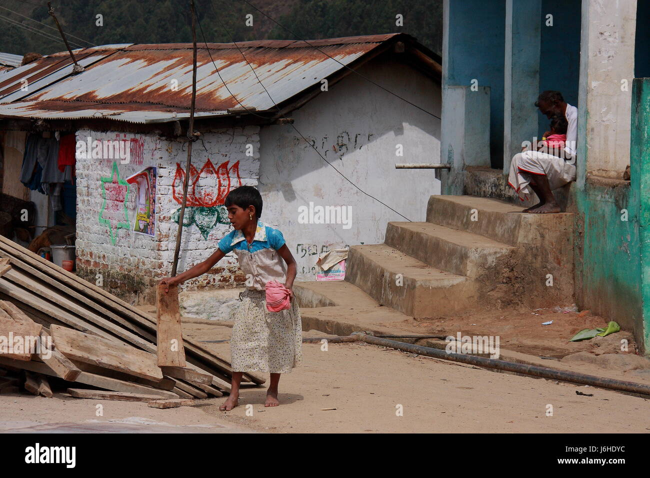 Child labour in India,shows the parents affection for son and daughter working,tamilnadu kerala boarder,south india,asia,PRADEEP - Stock Image