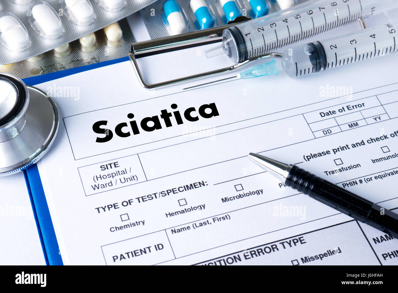 Sciatica doctor hand working Professional Medical Concept - Stock Image