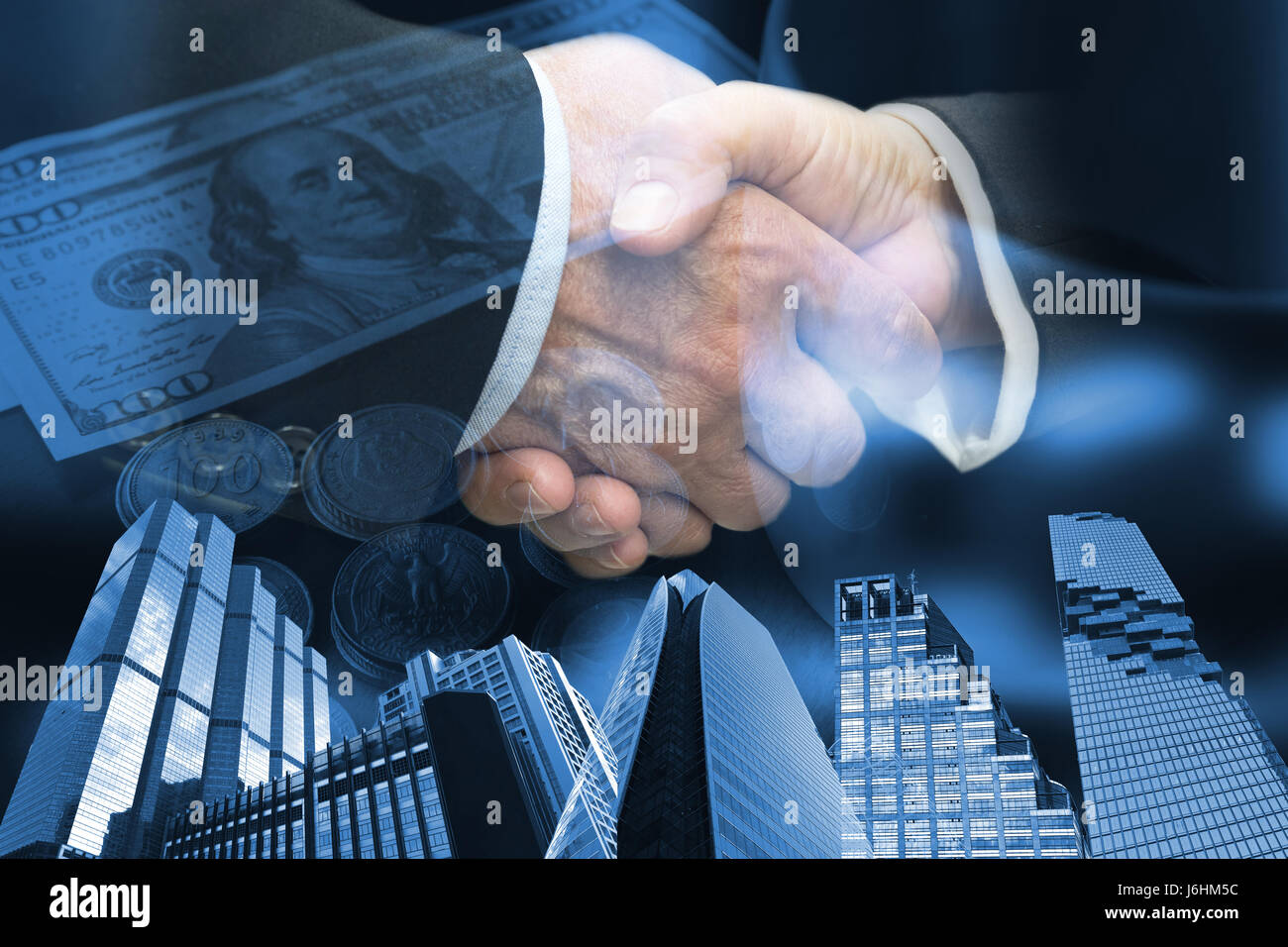 Two Business people shaking hands and abstract blue tone of buildings and dollar note background. Finishing up meeting - Stock Image