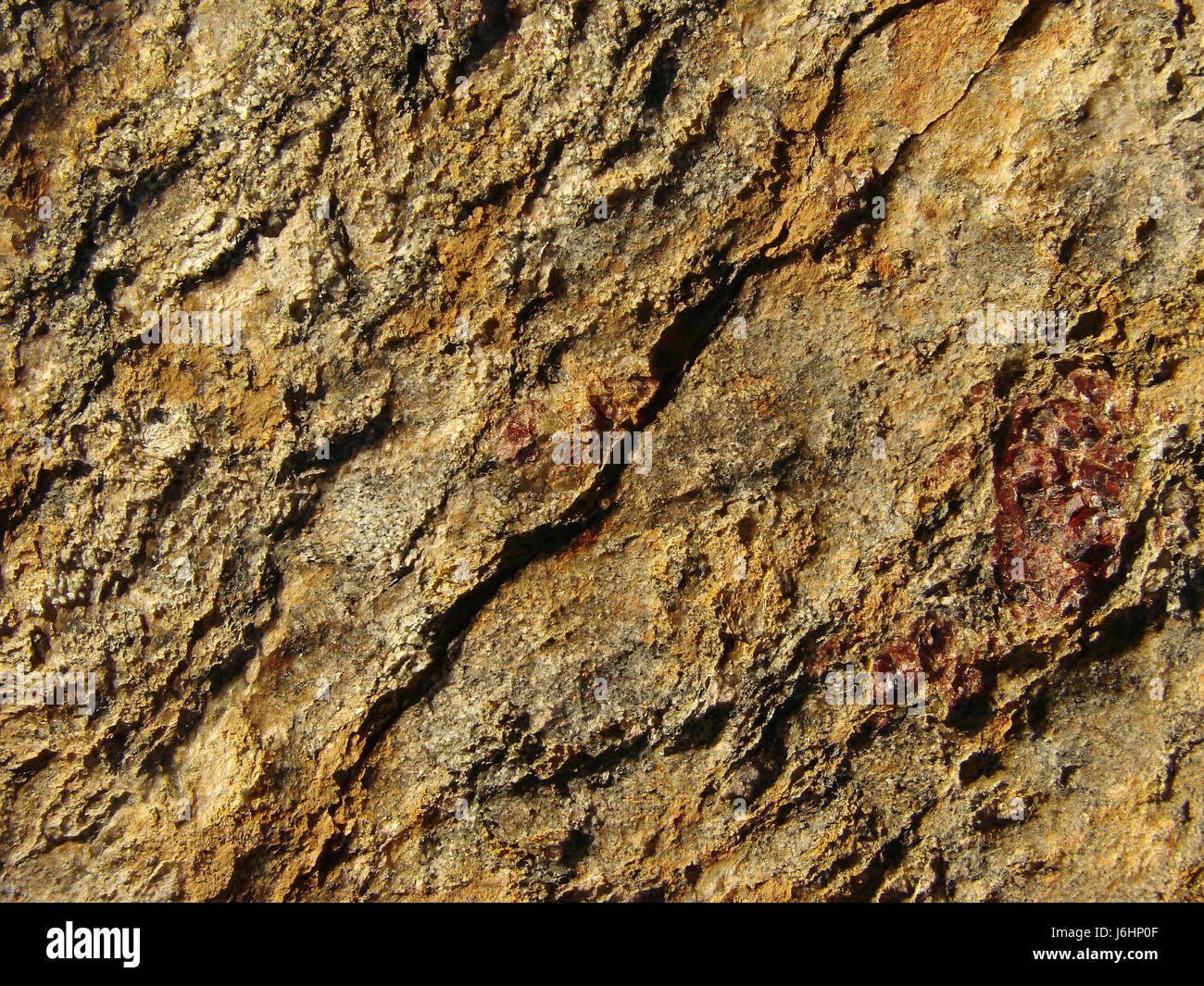 stone rock golden surface relief abstract wallpaper pattern geology solid