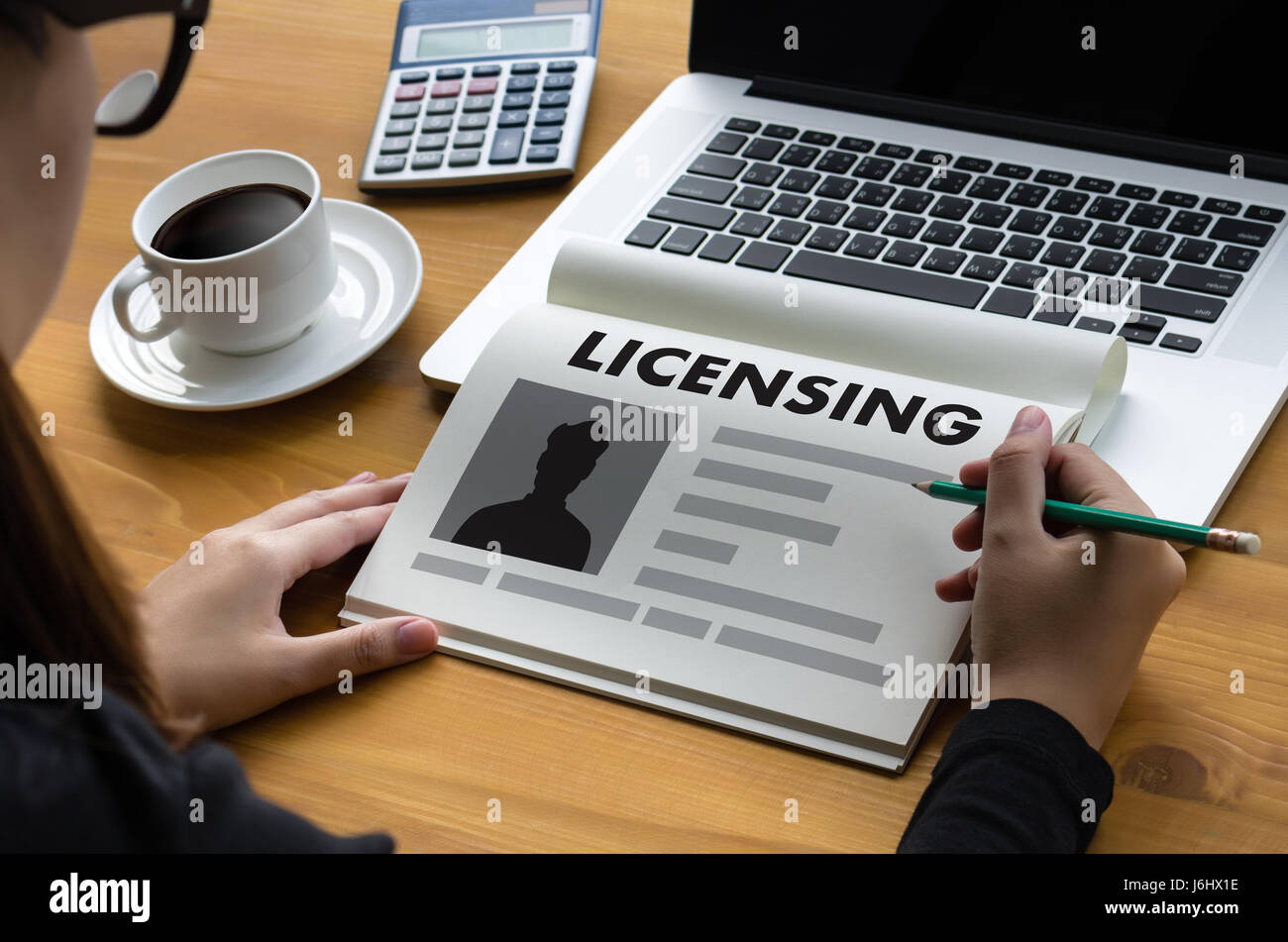 Patent license agreement licensing business man hand working on patent license agreement licensing business man hand working on laptop computer platinumwayz