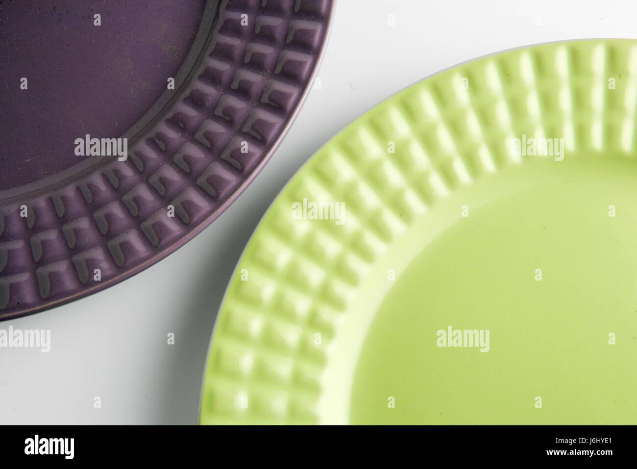 horizontal,violet,plates,two,green,2 plates,kitchen items,white background - Stock Image