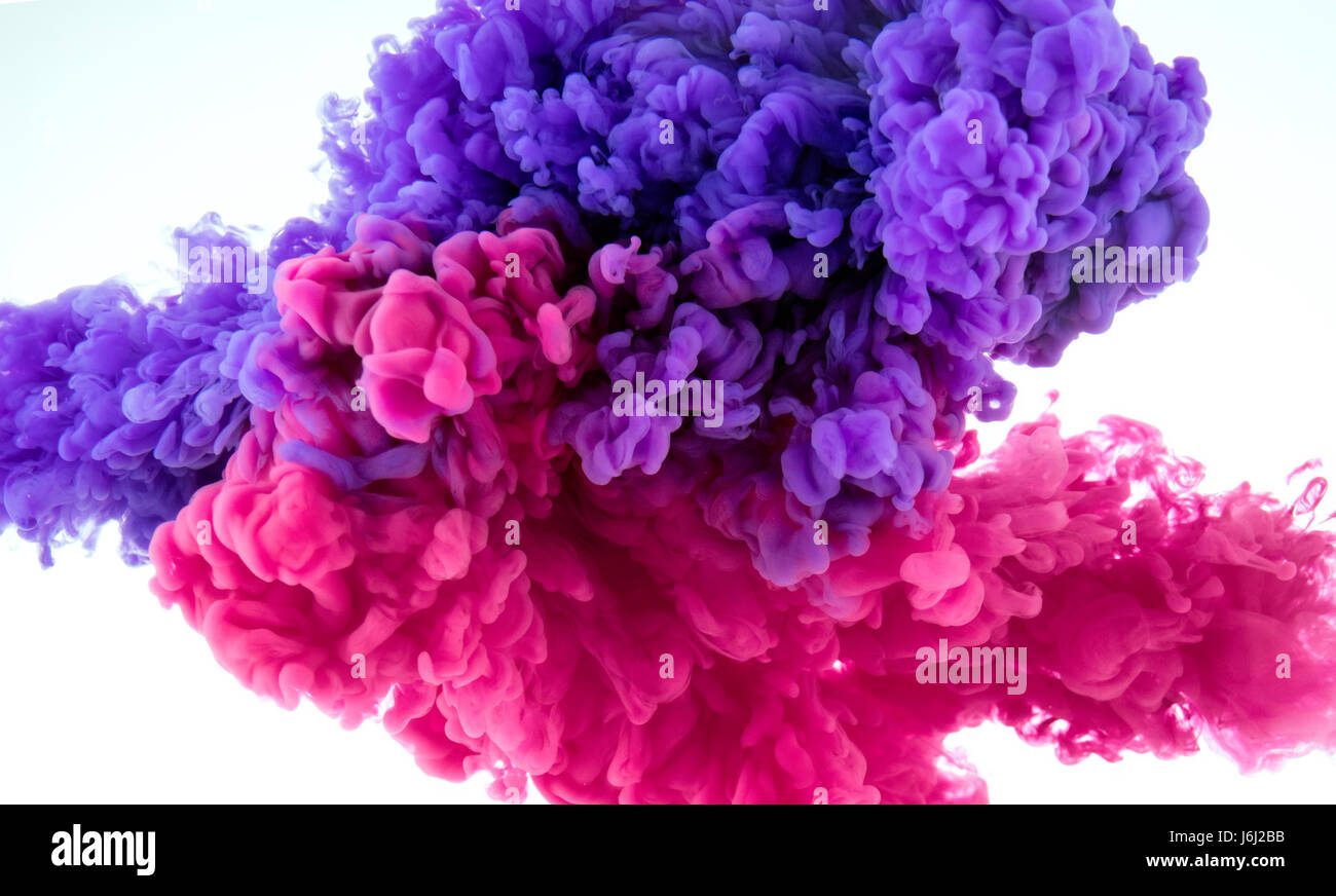 ink color splash in water two color mix background stock photo