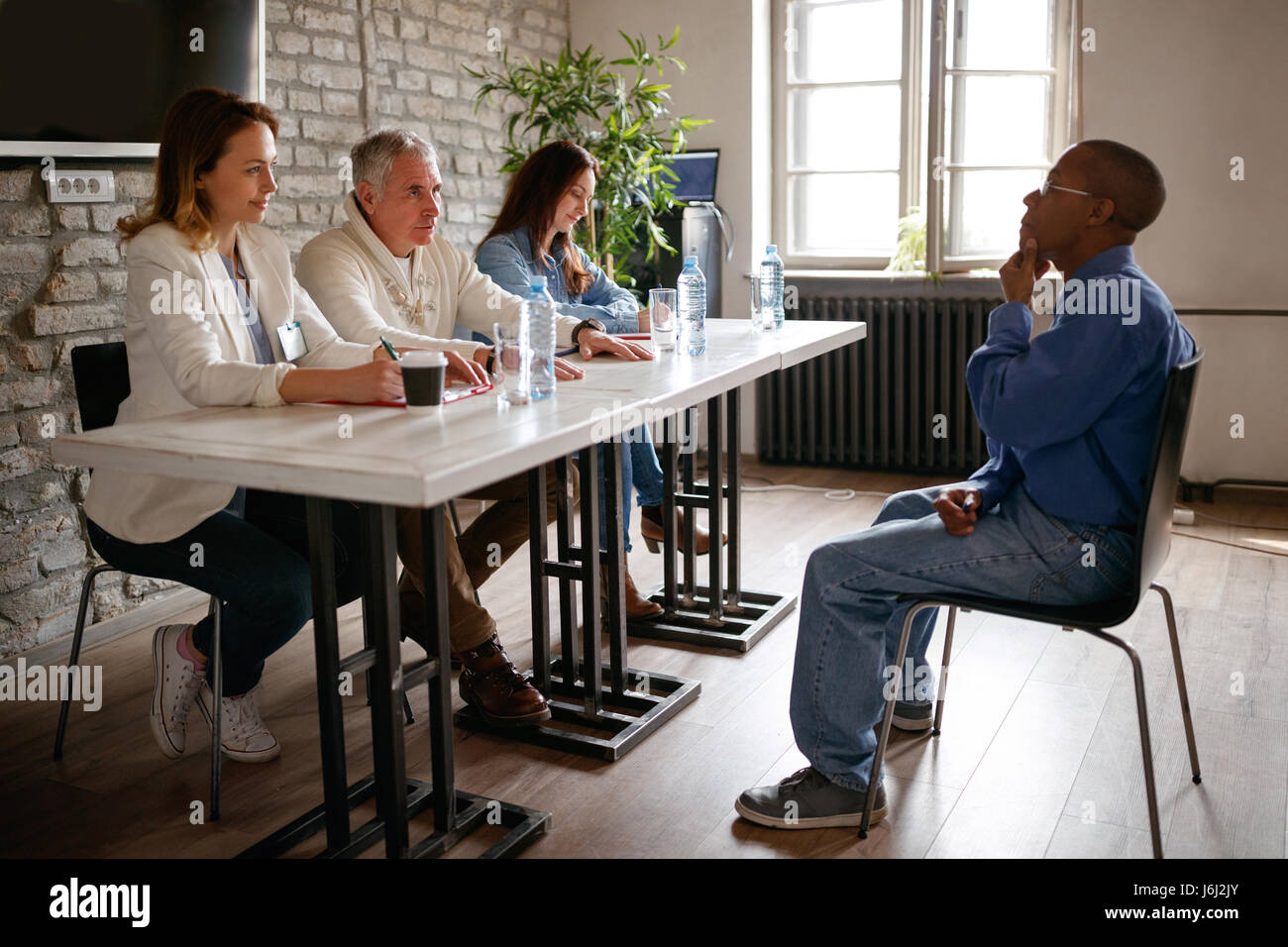 interview for job -candidate talking with business people team in the office - Stock Image