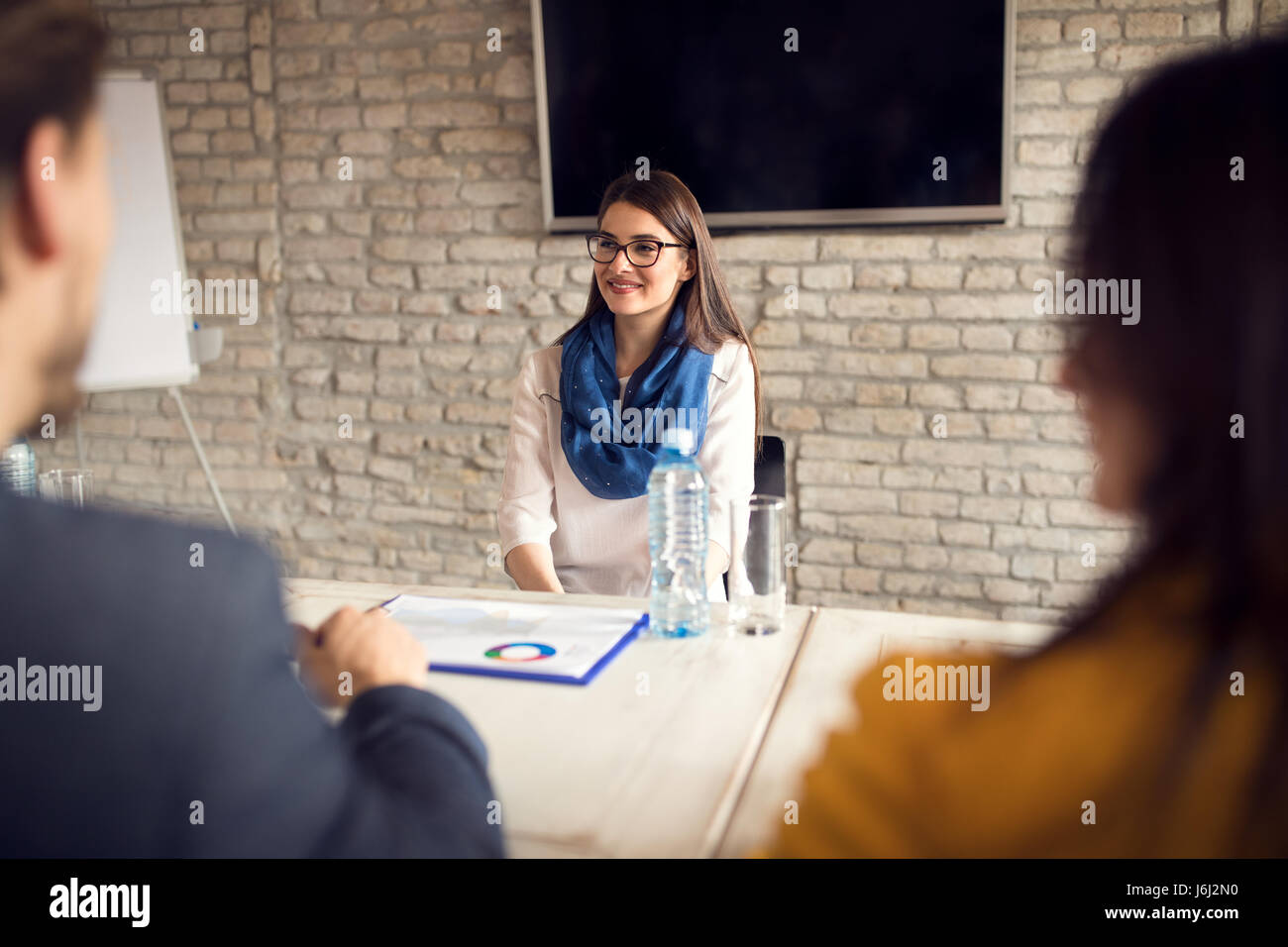 Female on job interview in company - Stock Image