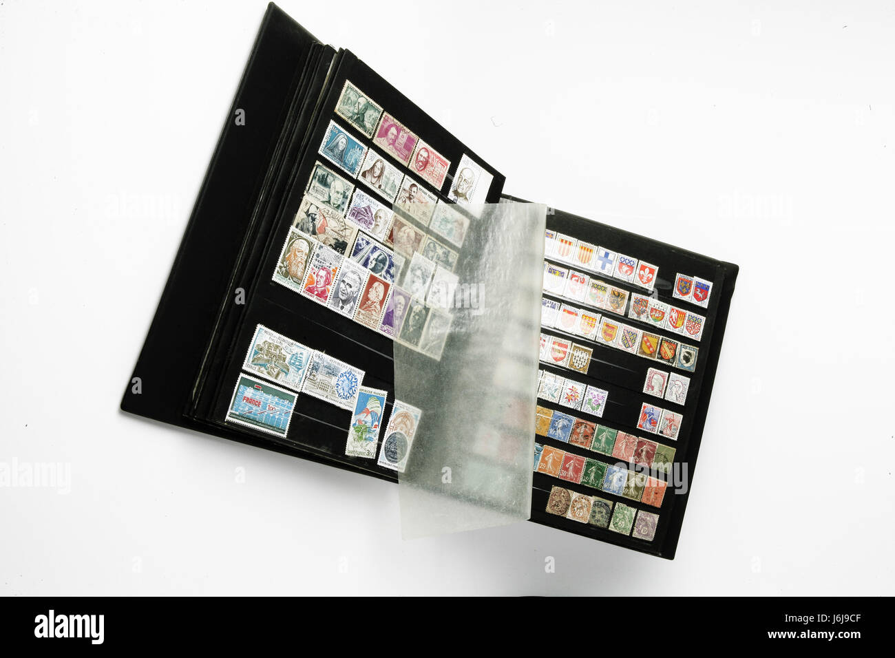 object,horizontal,stamp album,collectibles,white background - Stock Image
