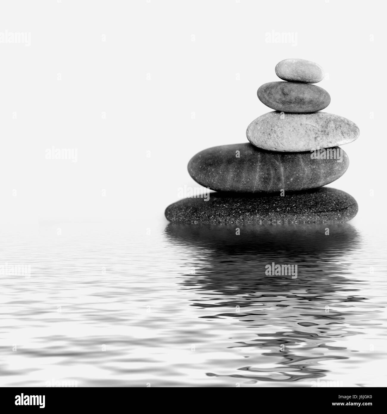 stone tower in water - Stock Image