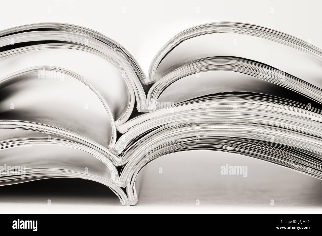 newspaper journal magazine publication sheet of paper paper heap pile newspaper - Stock Image